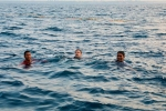 Rahul Gandhi swims in the Arabian Sea with Kerala fishermen